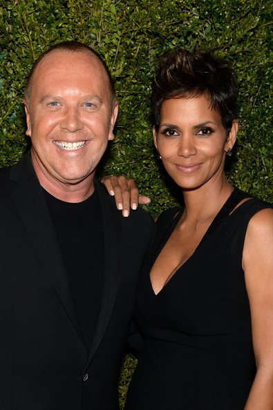 Michael Kors and Halle Berry attend a dinner in honor of Halle Berry as she joins Michael Kors and the United Nations World Food Programme to help fight world hunger. The event was held at The Pool Room at the Four Seasons on April 6, 2013 in New York City
