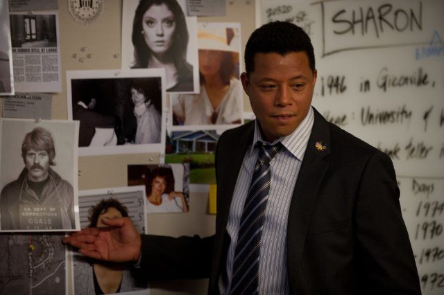 "Terrence Howard points to the photo of an FBI fugitive played by Robert Redford in ""The Company You Keep"""