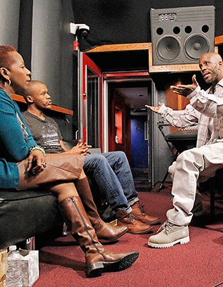 Iyanla sits with DMX and his son Xavier