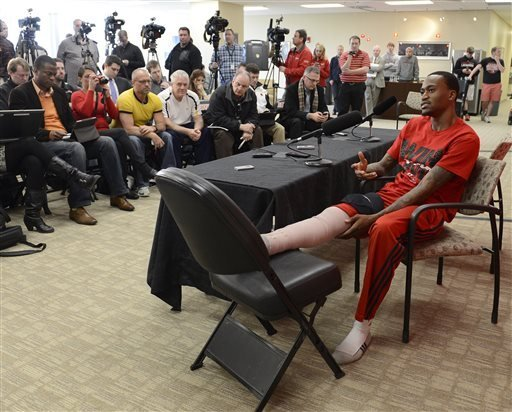 Louisville basketball player Kevin Ware answers questions during a press conference, Wednesday April 3, 2013, at the KFC Yum! Center practice facility in Louisville, Ky.