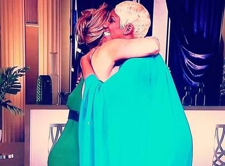 kim and nene hug
