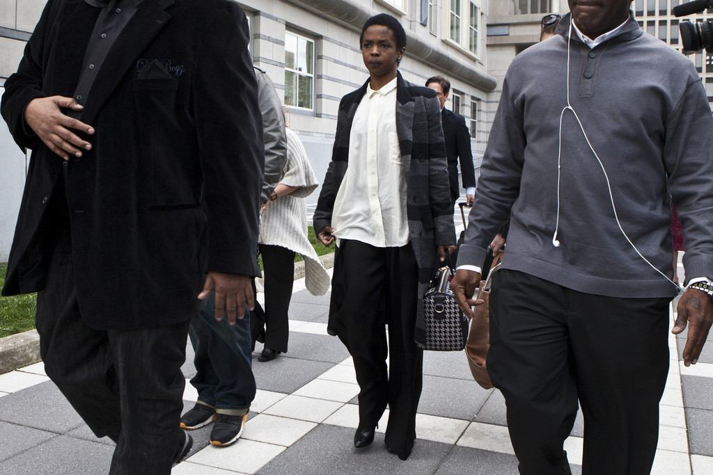 Signer Lauryn Hill is seen leaving court after the judge postpones her sentencing and gave her two weeks to pay back taxes April 22, 2013 in Newark, New Jersey.