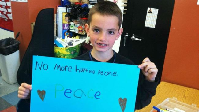 martin richard (with sign)