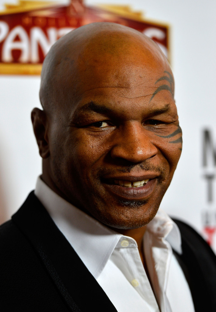 """Mike Tyson arrives at the opening Night Of """"Mike Tyson: Undisputed Truth"""" At The Pantages Theatre at the Pantages Theatre on March 8, 2013 in Hollywood"""