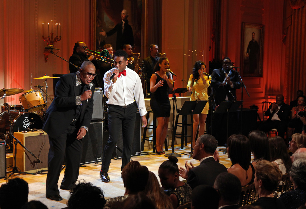 "Sam Moore (L) and Joshua Ledet perform ""Soul Man"" for President Barack Obama and first lady Michelle Obama (front row, C) during a concert of Memphis Soul music as part of the ""In Performance at the White House"" series in the East Room of the White House April 9, 2013 in Washington, DC"