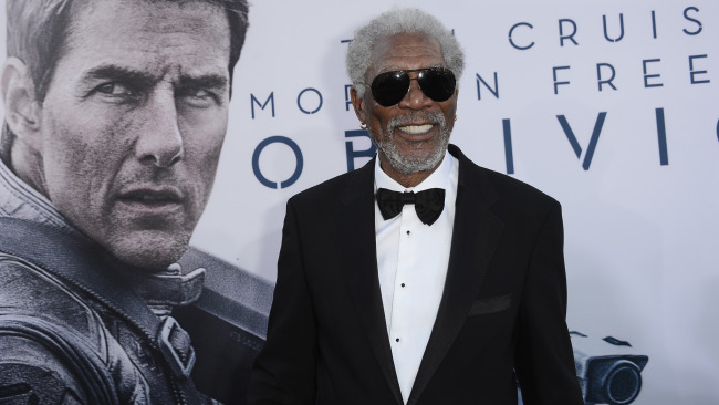 morgan freeman in front of 'oblivion' poster