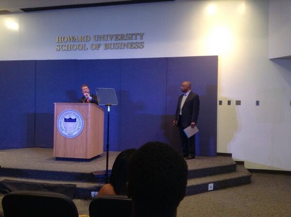 Paul making a point as Dean Kurt Schmoke, Howard University's General Counsel, looks on.