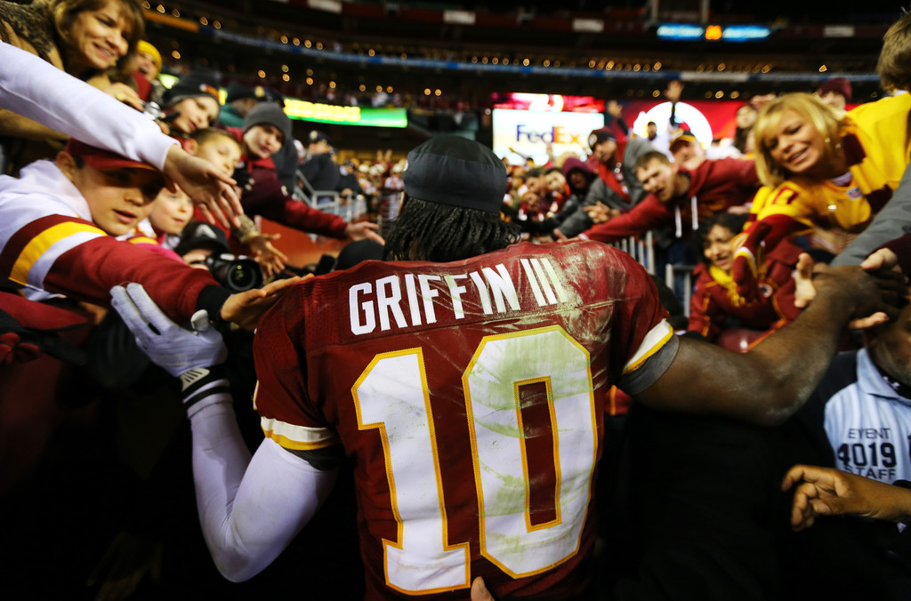 Robert Griffin III #10 of the Washington Redskins greets fans as he leaves the field after their 24 to 14 loss to the Seattle Seahawks during the NFC Wild Card Playoff Game at FedExField on January 6, 2013 in Landover, Maryland