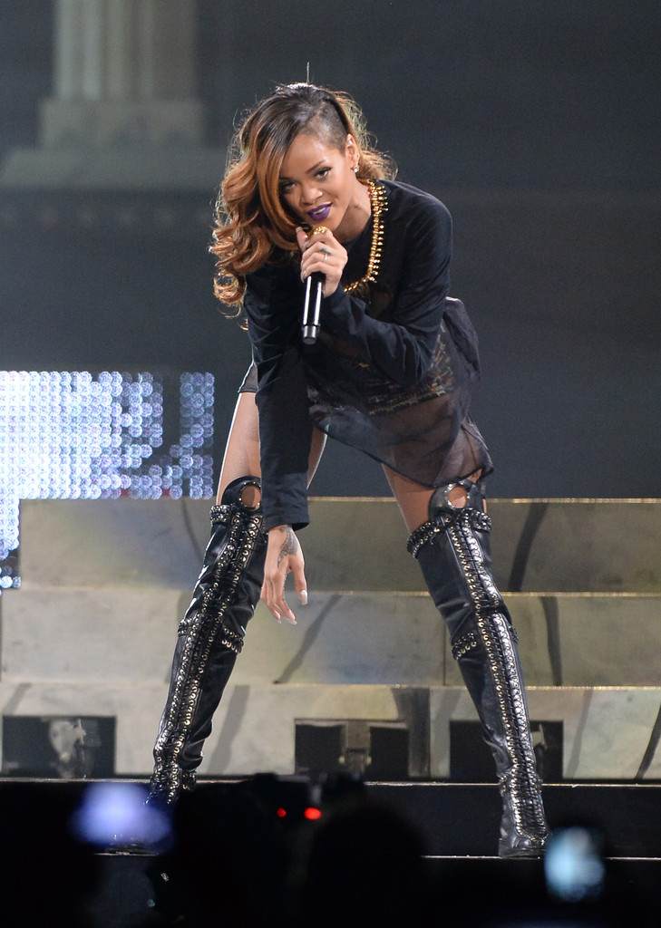 Singer Rihanna performs at Staples Center on April 8, 2013 in Los Angeles