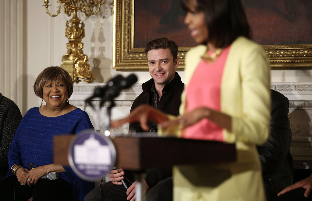 U.S. first lady Michelle Obama speaks as musicians Mavis Staples (L) and Justin Timberlake (2nd L) listen during an interactive student workshop at the State Dining Room of the White House April 9, 2013 in Washington, DC.