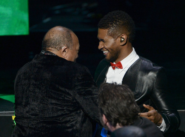 Singer Usher presents inductee Quincy Jones (L) the Ahmet Ertegun Award for Lifetime Achievement