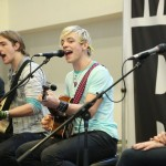R5 entertains the students.