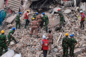 Bangladesh workers digging through rubble