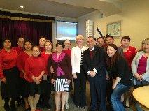 Hahn with Bishop Mendez and volunteers