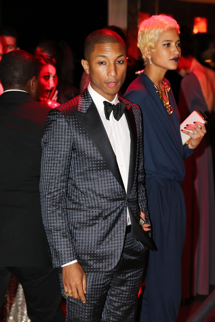 "Pharrell Williams and Helen Lasichanh attend the ""PUNK: Chaos To Couture"" Costume Institute Gala after party at The Standard hotel on May 6, 2013 in New York City"