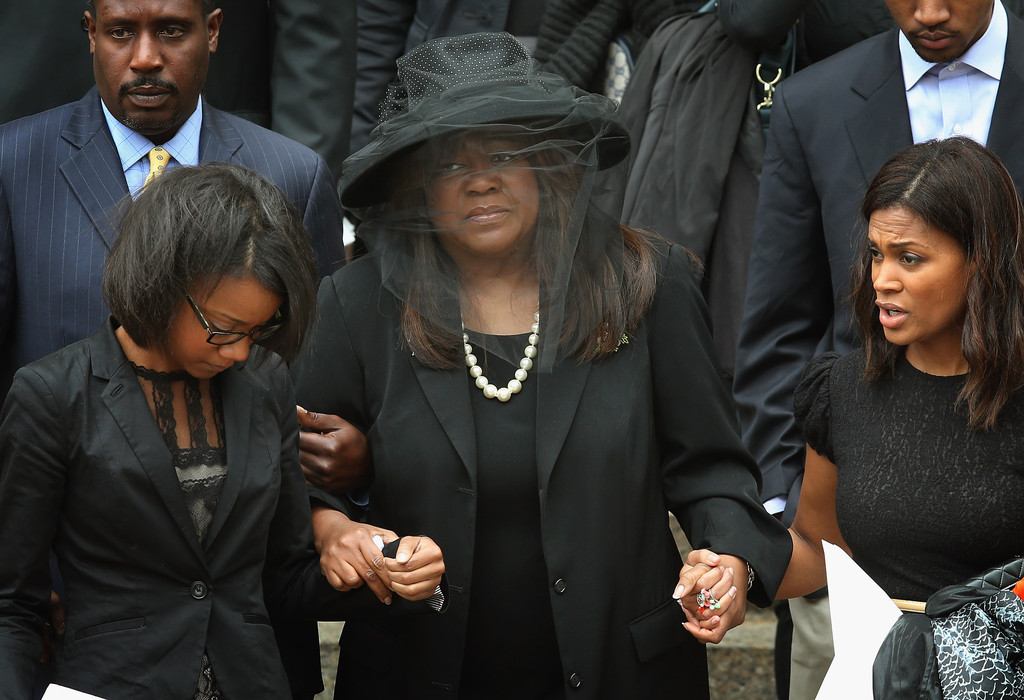 Chaz Ebert (C), the wife of film critic Roger Ebert, leaves Holy Name Cathedral following a funeral service for her husband April 8, 2013 in Chicago