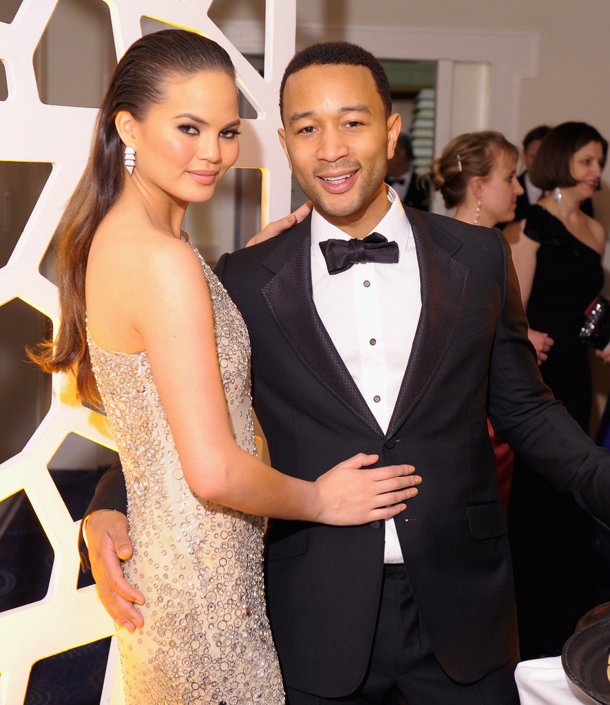 Chrissy Teigen and John Legend attend the TIME/CNN/PEOPLE/FORTUNE Pre-Dinner Cocktail Reception at Washington Hilton on April 27, 2013 in Washington, DC