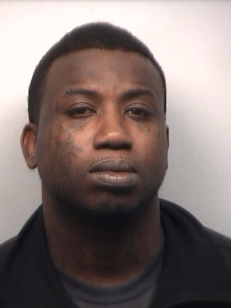 rapper Gucci Mane, real name Radric Davis, is seen in a police booking photo after his arrest for assault March 27, 2013 in Atlanta, Georgia