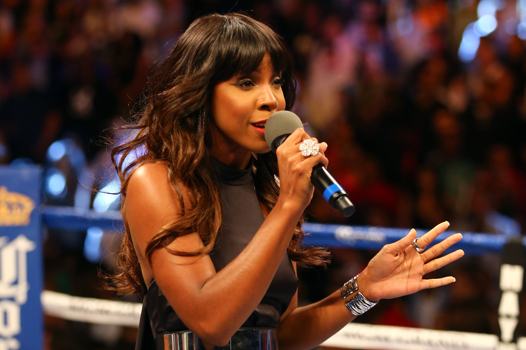 Singer Kelly Rowland performs the national anthem before Floyd Mayweather Jr. takes on Robert Guerrero in their WBC welterweight title bout at the MGM Grand Garden Arena on May 4, 2013 in Las Vegas
