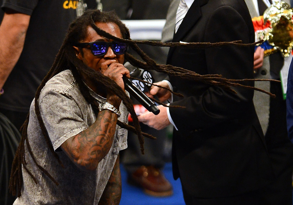 Rapper Lil Wayne performs as boxer Floyd Mayweather Jr. walks into the ring to take on Robert Guerrero in their WBC welterweight title bout at the MGM Grand Garden Arena on May 4, 2013 in Las Vegas