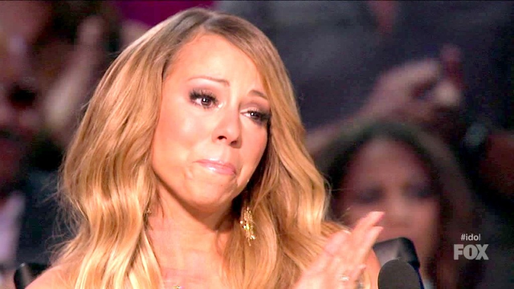 """American Idol"" judge Mariah Carey applauds booted contestant Amber Holcomb on Thursday, May 2, 2013."