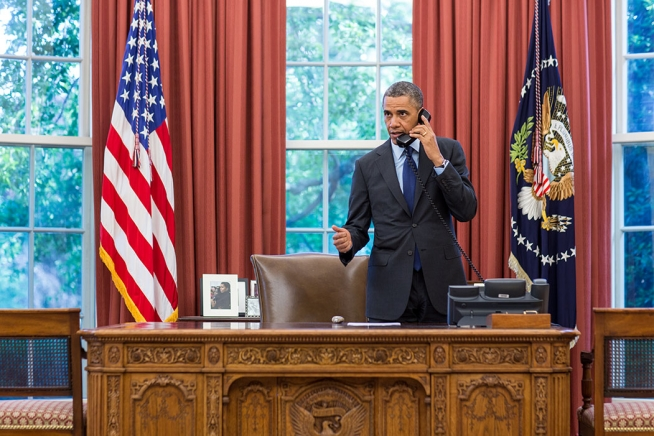 President Barack Obama talks on the phone with Oklahoma Governor Mary Fallin in the Oval Office, May 20, 2013.