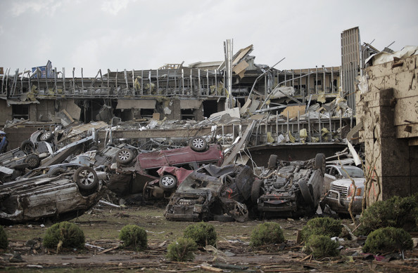 Flipped vehicles are piled up outside the heavily damaged Moore Medical Center after a powerful tornado ripped through the area on May 20, 2013 in Moore, Oklahoma.