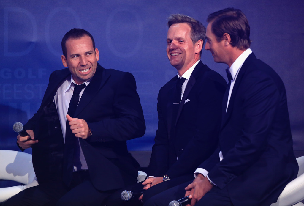 Sergio Garcia of Spain (L) talks with Luke Donald of England and Nicolas Colsaerts of Belgium (R) on stage at the European Tour Dinner, prior to the BMW PGA Championship, at the Sofitel Hotel, Heathrow Airport on May 21, 2013 in London, England