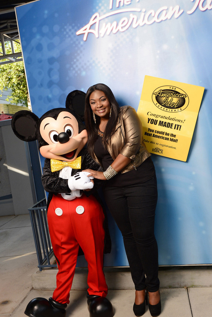 """""""American Idol"""" season 12 winner, Candice Glover poses with Mickey Mouse at the """"American Idol Experience"""" at Disney's Hollywood Studios on May 27, 2013 in Lake Buena Vista, Florida."""