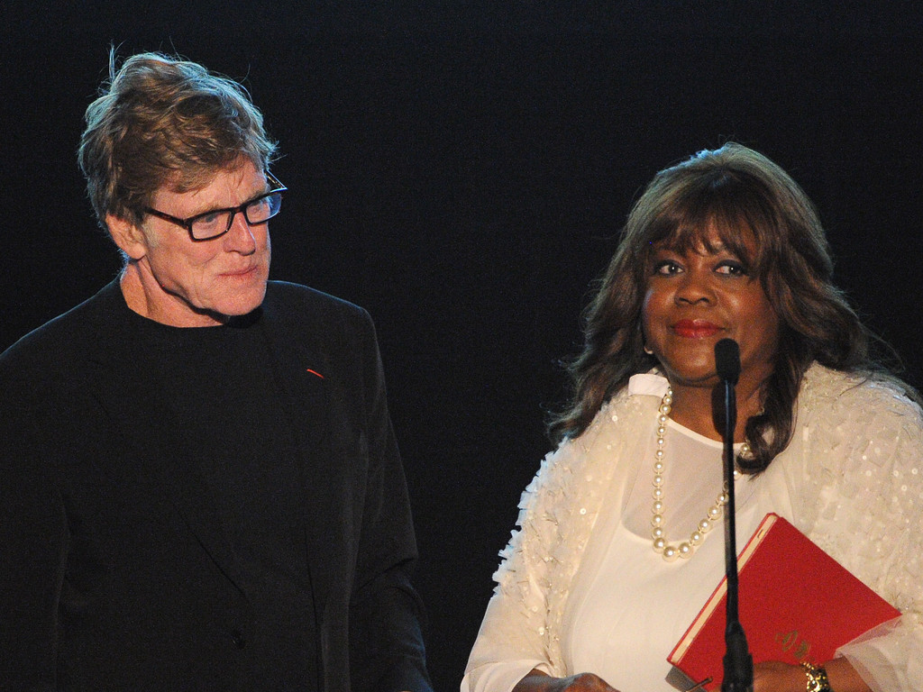 Sundance Institute President and Founder Robert Redford presents the Vanguard Leadership Award on behalf of Roger Ebert to Chaz Ebert onstage at the 2013 Celebrate Sundance Institute Los Angeles Benefit hosted by Tiffany & Co. at The Lot on June 5, 2013 in West Hollywood
