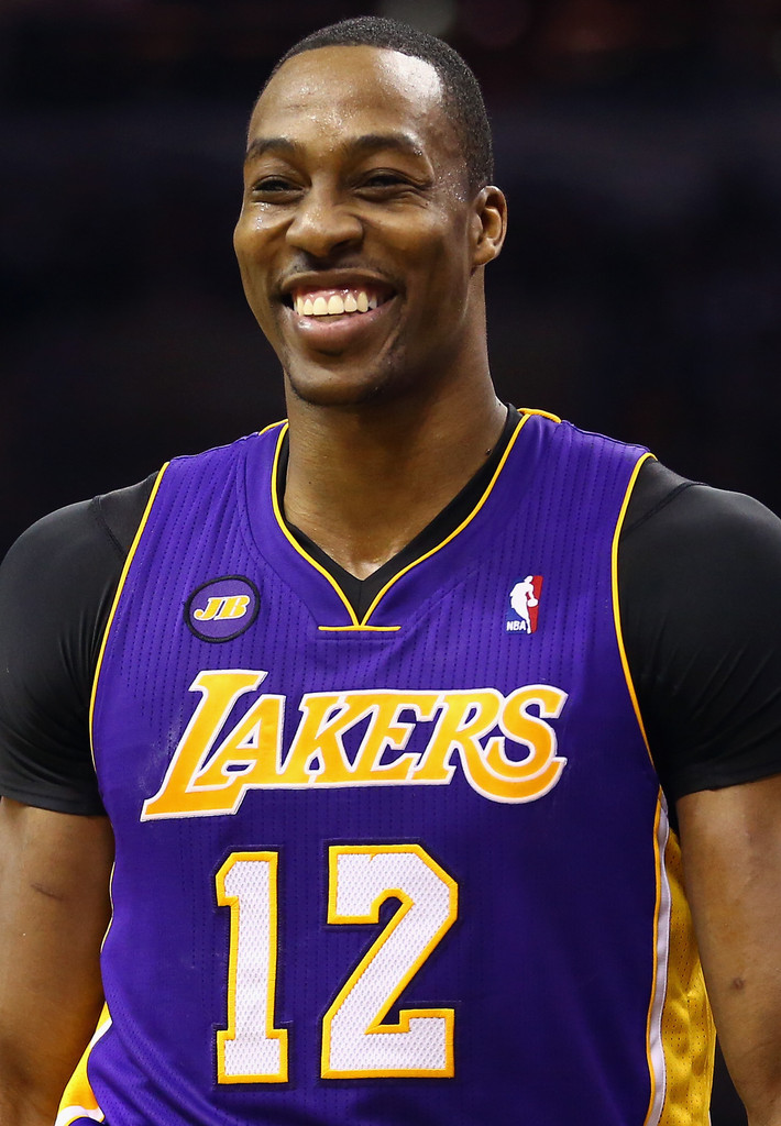 Dwight Howard #12 of the Los Angeles Lakers smiles during Game One of the Western Conference Quarterfinals of the 2013 NBA Playoffs at at AT&T Center on April 21, 2013 in San Antonio, Texas