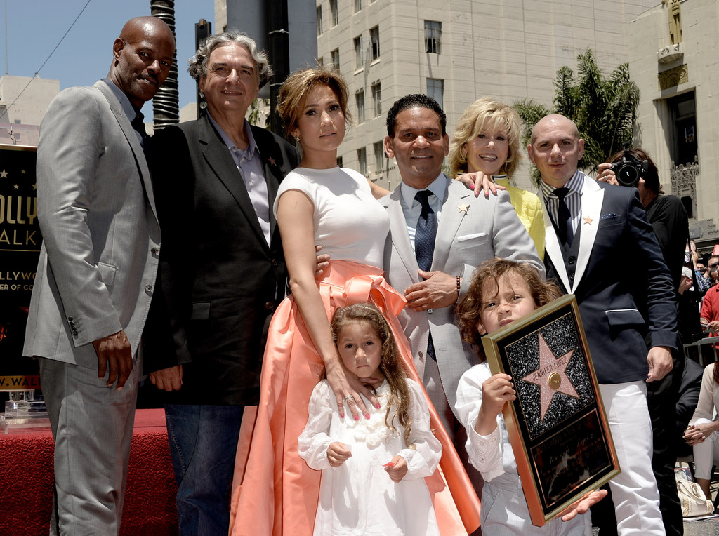 (L-R) Actor Keenan Ivory Wayans, director Gregory Nava, actress/singer Jennifer Lopez, manager Benny Medina, actress Jane Fonda, singer Pitbull, Lopez's children Emme (front, left and Max pose as Lopez is honored with the 2500th star on the Hollywood Walk of Fame on June 20, 2013 in Los Angeles