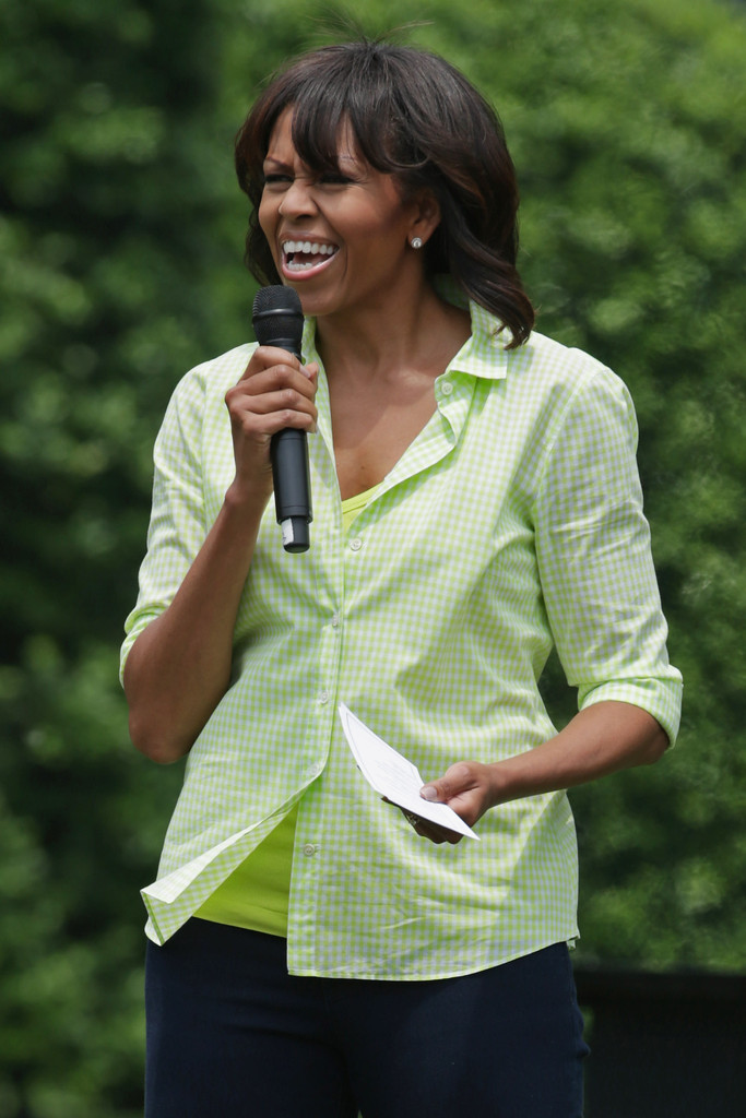 First lady Michelle Obama speaks to School children before they harvest the summer crop from the White House Kitchen Garden at the White House May 28, 2013 in Washington, DC. The first lady was joined by students from Somerville, Massachusettes, Knox County, Tennessee, Milton, Vermont, Washington, DC; and Union Beach and Ship Bottom, New Jersey.