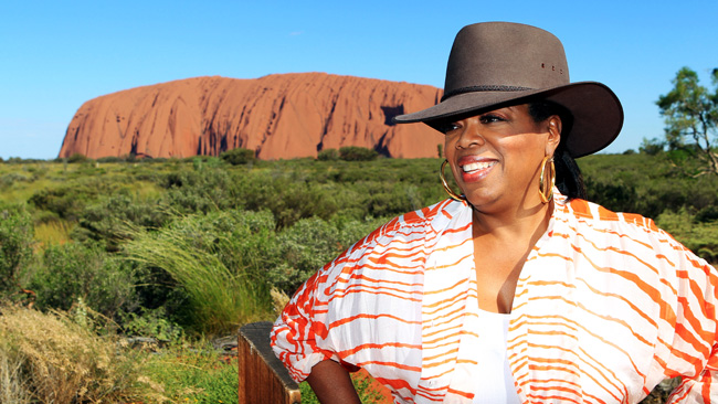 Oprah in front of Ayers Rock in Australia (2010)