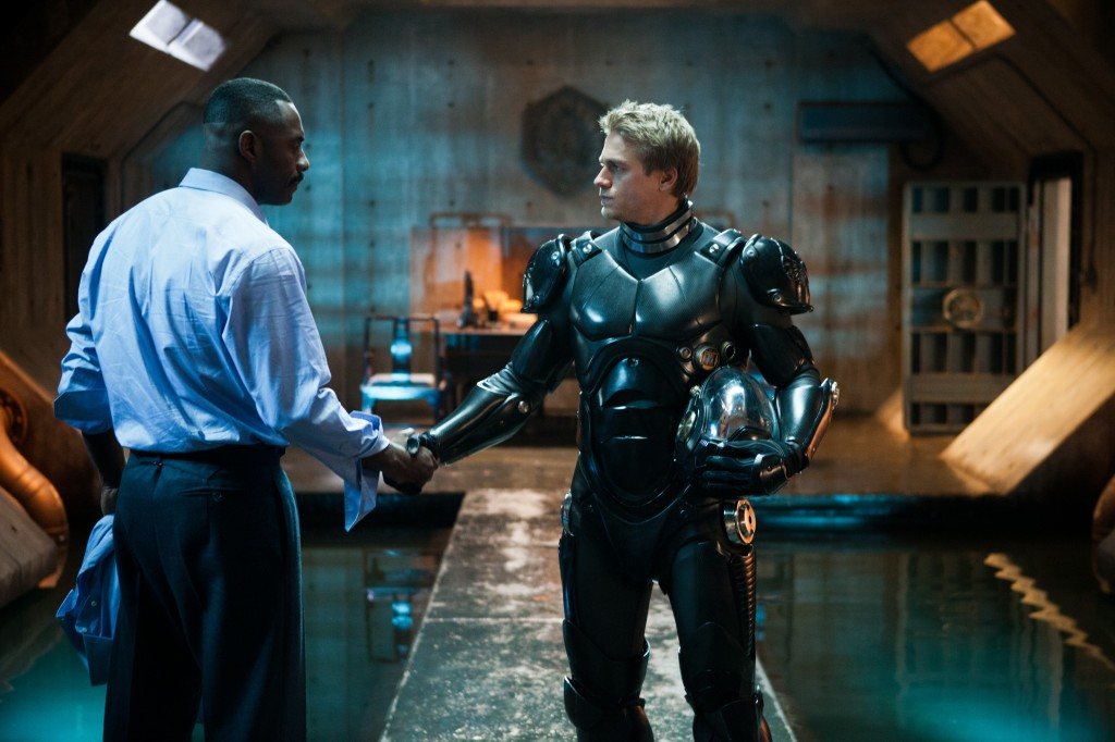 "(L-r) IDRIS ELBA as Stacker Pentecost and CHARLIE HUNNAM as Raleigh Beckett in Warner Bros. Pictures' and Legendary Pictures' sci-fi action adventure ""Pacific Rim,"" a Warner Bros. Pictures release."