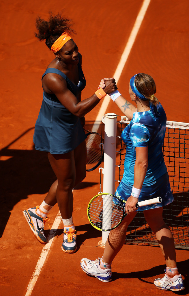 Serena Williams of United States of America shakes hands at the net with Svetlana Kuznetsova of Russia after their Women's Singles Quarter-Final match against on day ten of the French Open at Roland Garros on June 4, 2013 in Paris, France