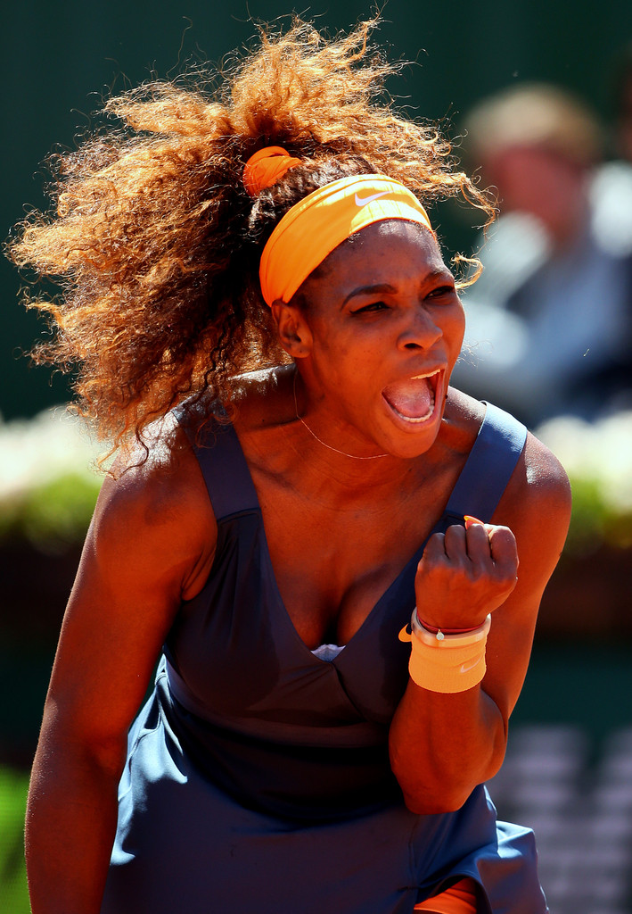 Serena Williams of United States of America celebrates a point during her Women's Singles Quarter-Final match against Svetlana Kuznetsova of Russia on day ten of the French Open at Roland Garros on June 4, 2013 in Paris, France