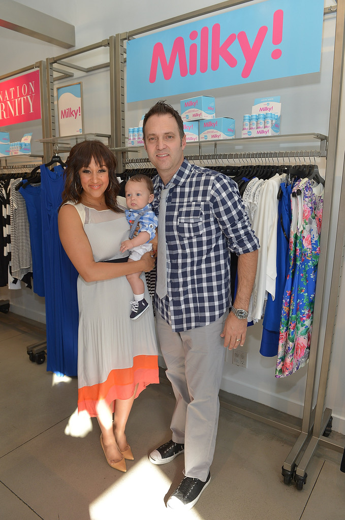 Tamera Mowry with son Aden Housley and husband Adam Housley attend the Milky! launch event at A Pea In The Pod on May 2, 2013 in Beverly Hills, California
