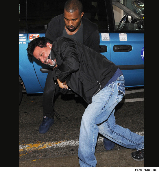 Kanye West attacking paparazzi photographer. Photo by TMZ.