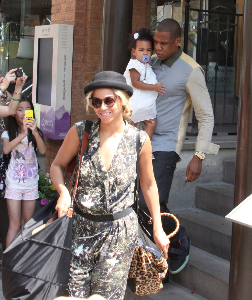 Jay-Z and Beyonce Knowles take their daughter Blue Ivy out to lunch at the Cafe Nervosa in Toronto on July 17, 2013