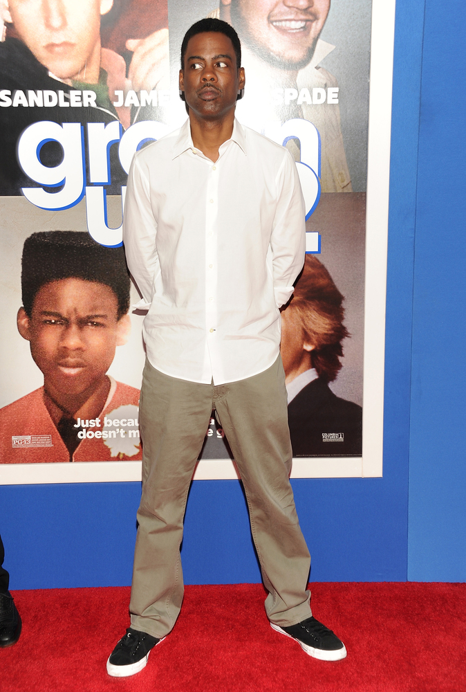 "Actor Chris Rock attends the premiere of ""Grown Ups 2"" at the AMC Loews Lincoln Square on Wednesday, July 10, 2013 in New York."