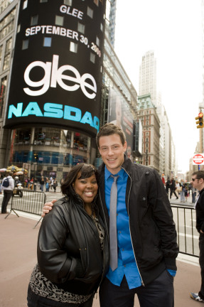 GLEE: Amber Riley (L) and Cory Monteith (R) of GLEE ring the NASDAQ closing bell in New York City, NY on Wednesday, Sept. 30. ©2009 Fox Broadcasting Co. CR: Jeff Neira/FOX