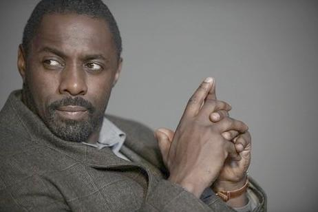 idris elba (hands as gun)