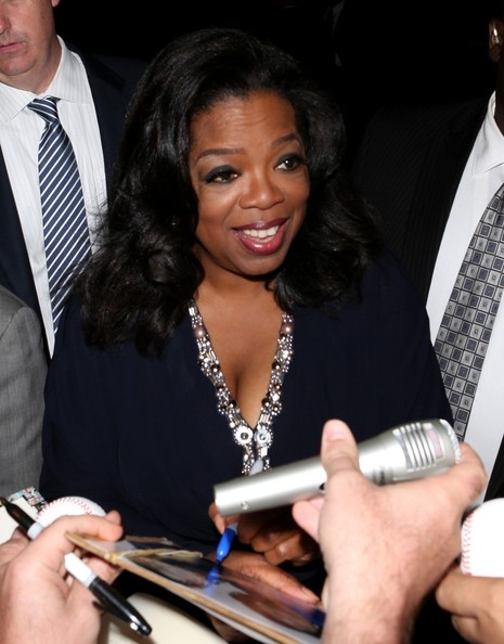 Oprah Winfrey greets her fans and signs autographs at Harvard University in Cambridge on May 29, 2013