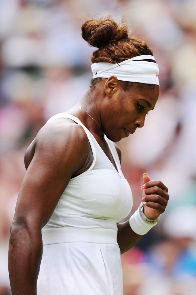 Serena Williams of United States of America looks dejected during her Ladies' Singles fourth round match against Sabine Lisicki of Germany on day seven of the Wimbledon Lawn Tennis Championships at the All England Lawn Tennis and Croquet Club on July 1, 2013 in London, England