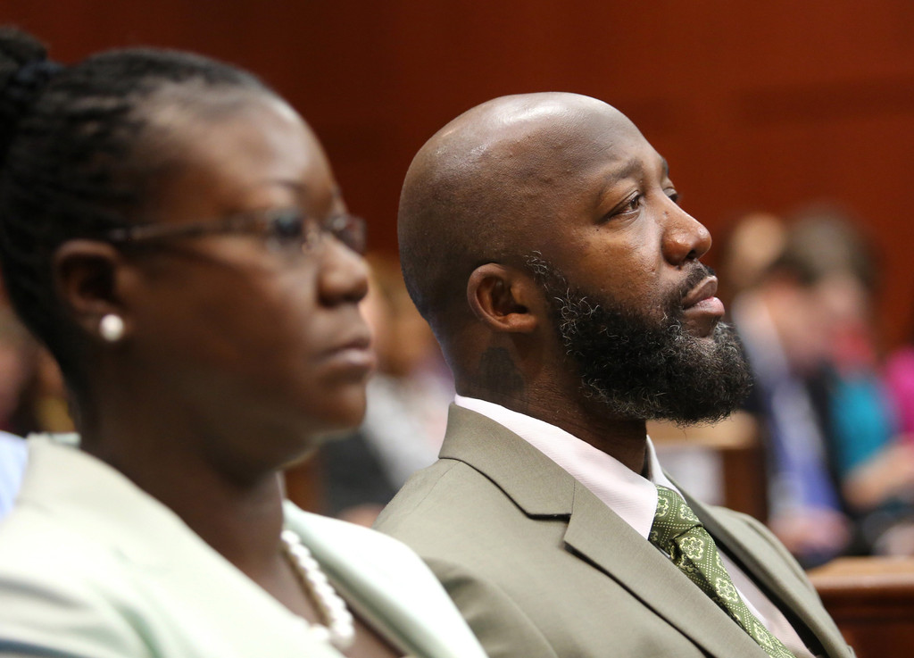 Trayvon Martin's mother Sybrina Fulton and father Tracy Martin watch watch the defense closing arguments in George Zimmerman's murder trial July 12, 2013 in Sanford, Florida