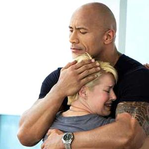 "TNT's new reality show ""The Hero"" mentor Dwayne ""The Rock"" Johnson comforting one of the nine contestants Patty ONeil."