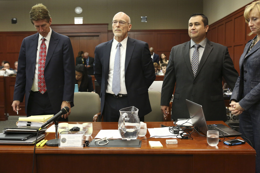 Defendant George Zimmerman (2nd R) stands with his defense counsel Mark O'Mara (L) Don West, (2nd L) and Lorna Truett during his murder trial during his murder trial July 10, 2013 in Sanford, Florida