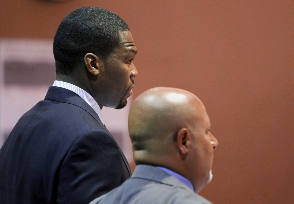 Curtis Jackson appears with his lawyer Scott Leemon during an arraignment at a Van Nuys Courthouse in Los Angeles on Monday, Aug. 5, 2013