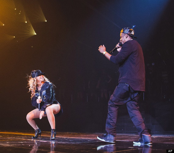 "Jay Z, left,  joins his wife Beyonce onstage during Beyonce's ""Mrs. Carter Show World Tour 2013"", on Monday, Aug. 5, 2013 at the Barclays Center in the Brooklyn borough of New York."